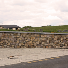 stone-wall-with-stone-capping